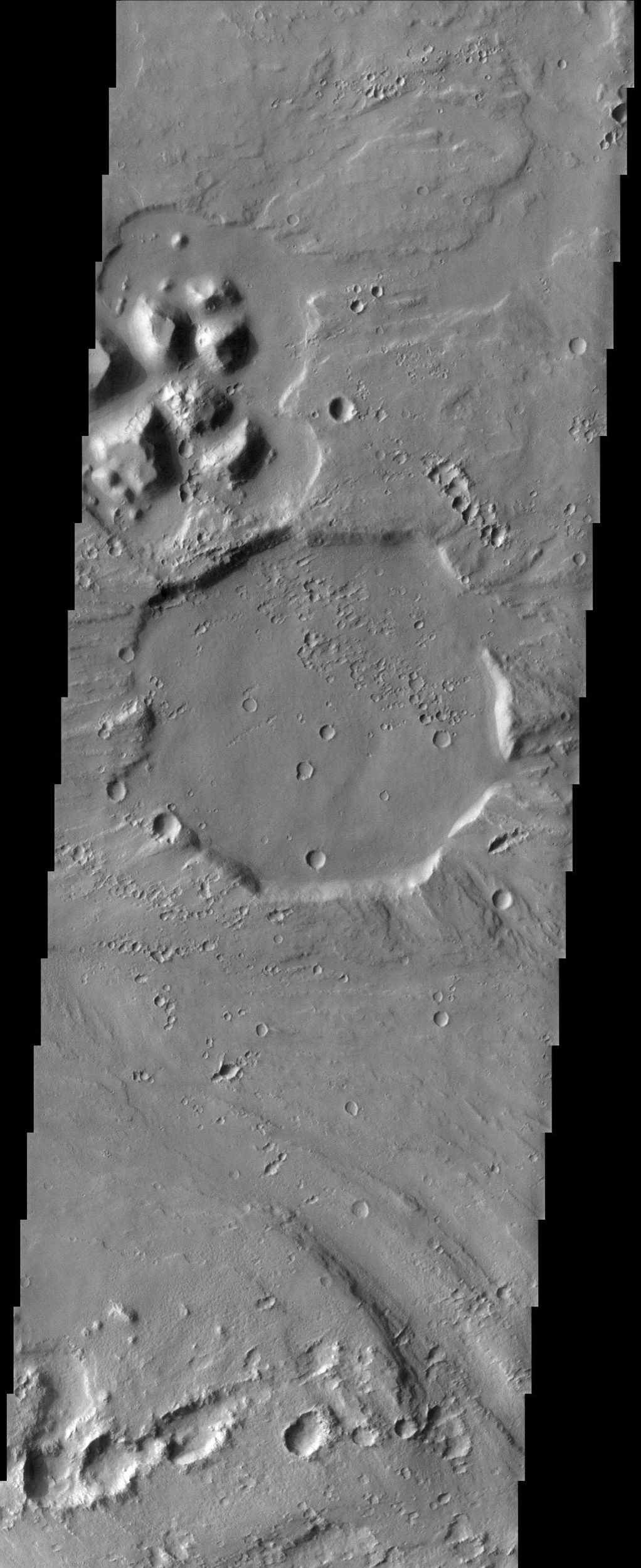 With its rim eroded off by catastrophic floods in Tiu Vallis and its strangely angular shape, this 12 km (about 7.5 mile) diameter crater imaged by NASA's Mars Odyssey spacecraft looks vaguely like a stop sign.