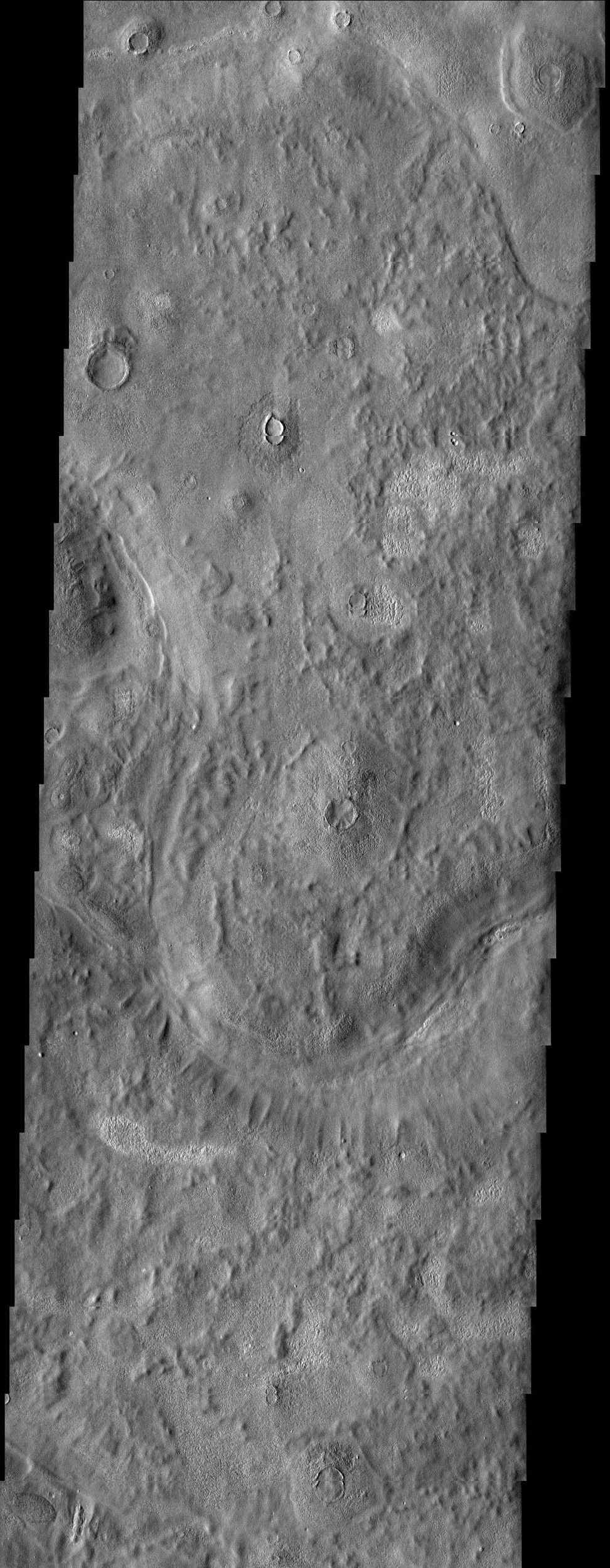 An unusual mix of textures is featured in this image from NASA's Mars Odyssey spacecraft of a surface east of the Phlegra Montes. Scabby mounds, commonly occurring around degraded craters, mix with a more muted, knobby terrain.