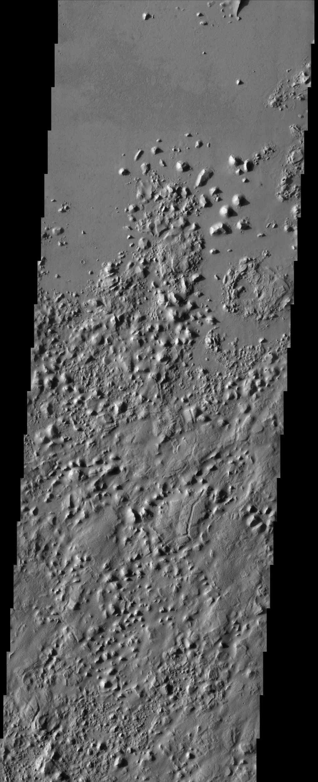The smooth plains of Elysium embay the blocky broken up highlands of Aeolis in this image from NASA's Mars Odyssey spacecraft. The plains have been interpreted by researchers to be possibly mudflows or lava flows.