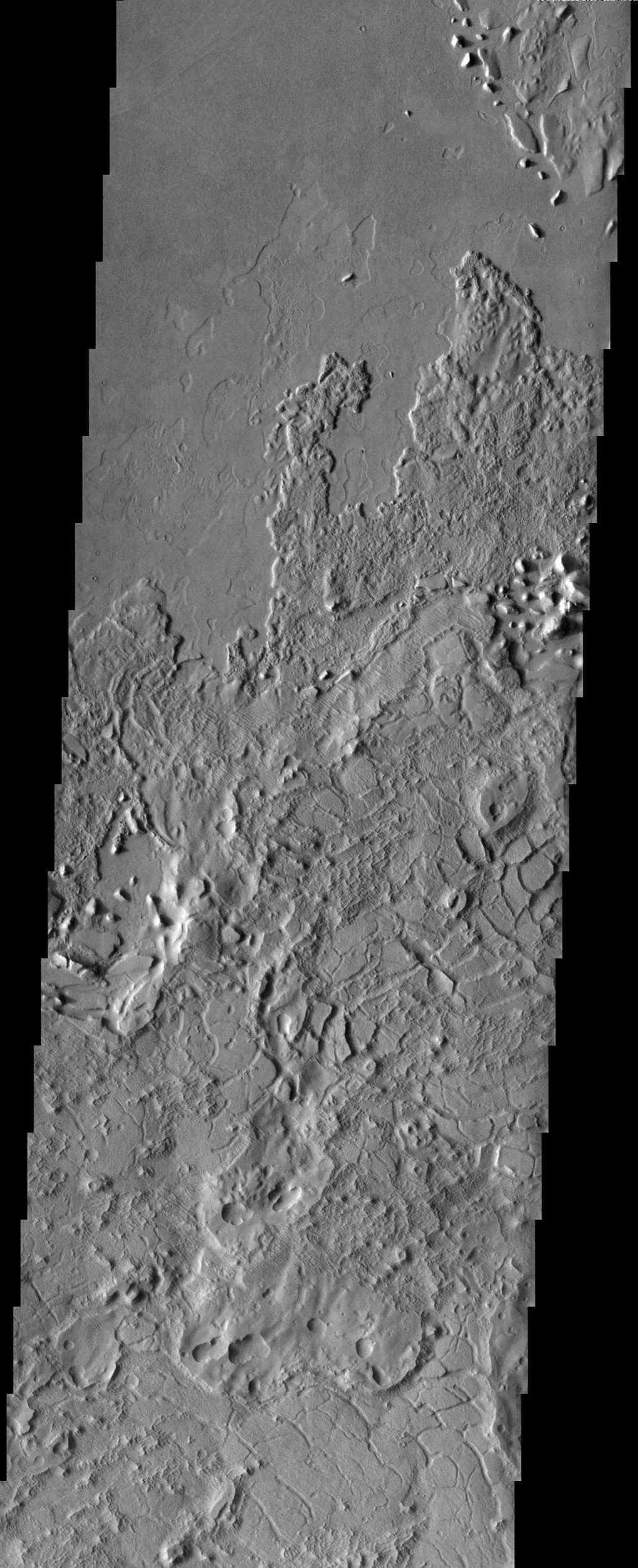 This image from NASA's Mars Odyssey spacecraft shows a crazy mixture of bizarre surface features in Lucus Planum.