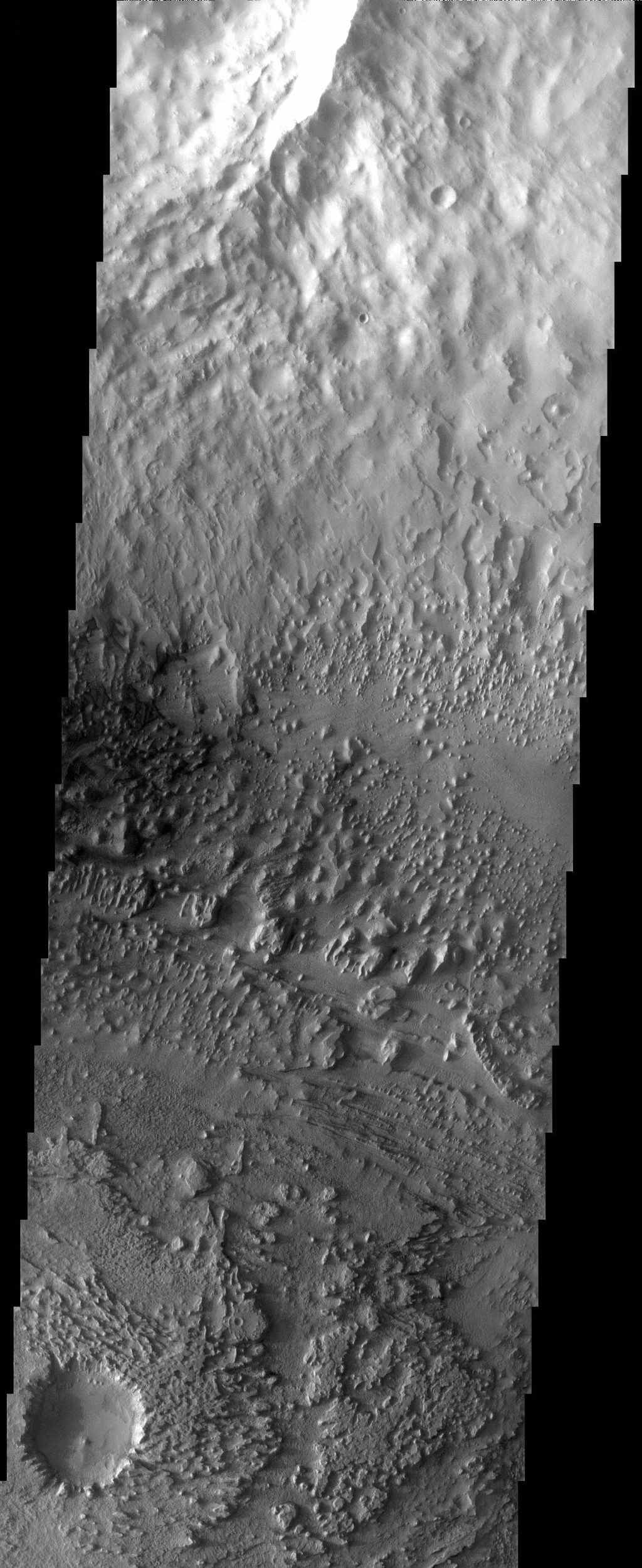 Streamlined buttes and mesas are left as remnants of an erosive wind that has carried away sediments and even the rim of a small crater in this image from NASA's Mars Odyssey spacecraft.