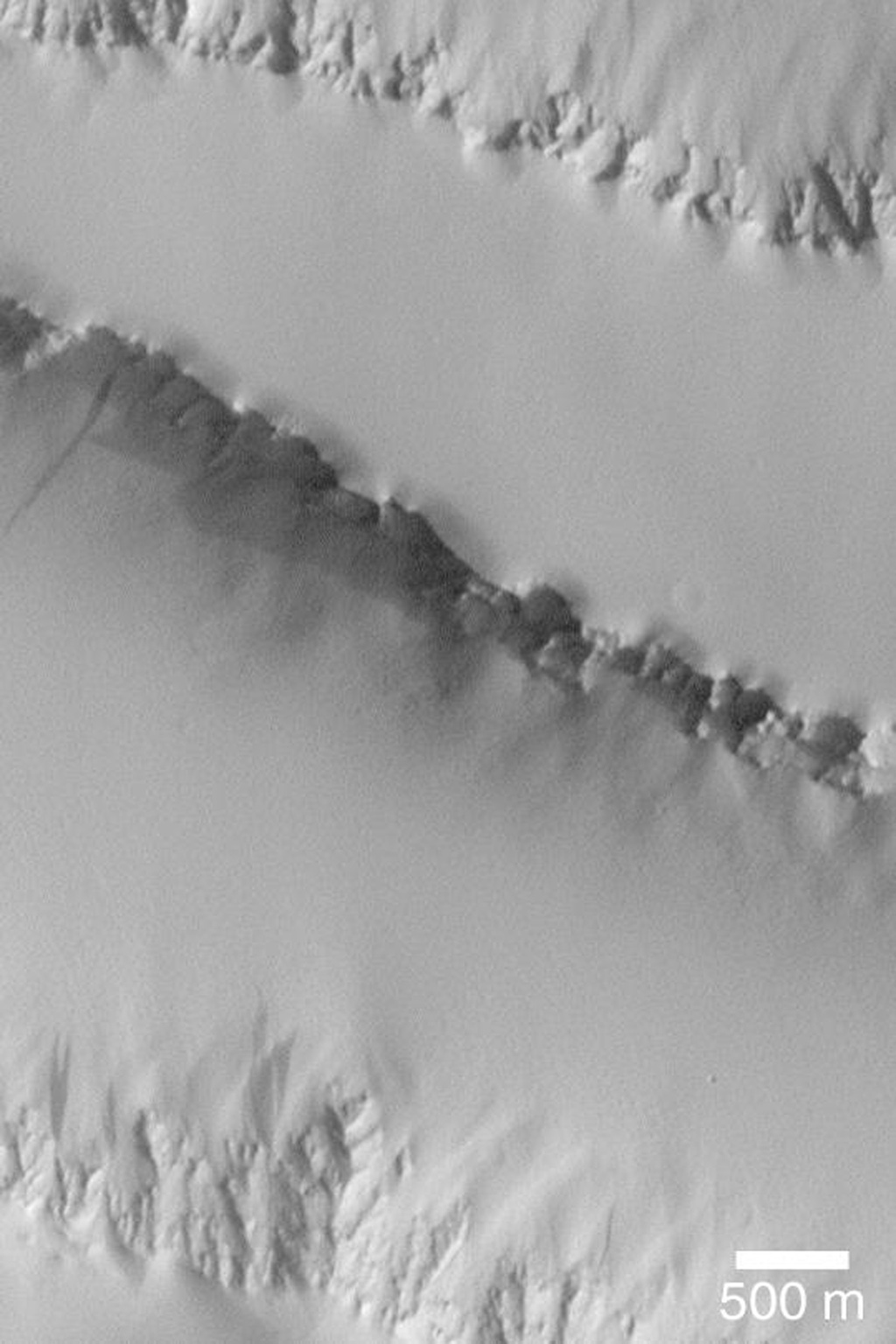 NASA's Mars Global Surveyor shows a thick mantle of dust covering lava flows north of Pavonis Mons on Mars so well that the flows are no longer visible.