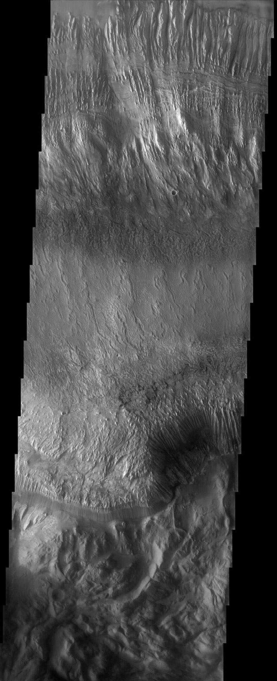 This image taken by NASA's 2001 Mars Odyssey shows Hebes Chasma, the northernmost canyon of Mars' vast Valles Marineris system.