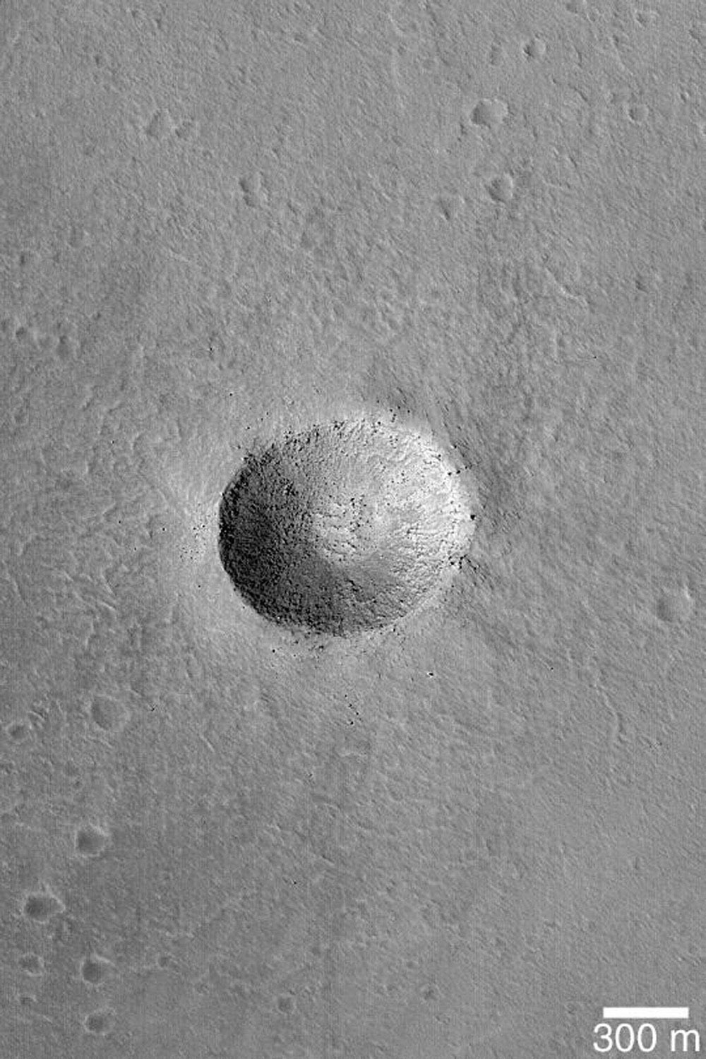NASA's Mars Global Surveyor shows a crater on the floor of the caldera, a large volcanic/collapse crater, of a giant martian volcano, Arsia Mons on Mars.