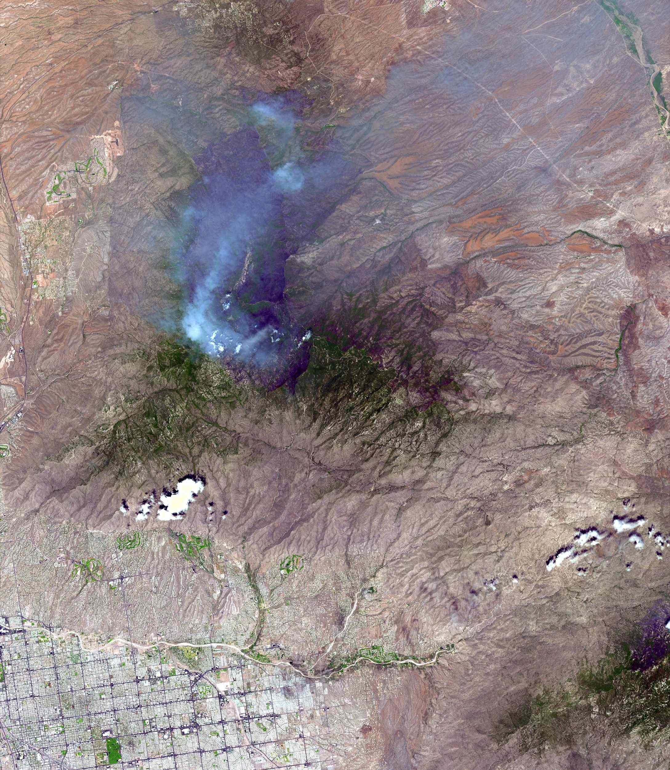 On June 26, NASA's Terra satellite acquired this image of the Aspen fire burning out of control north of Tucson, AZ.