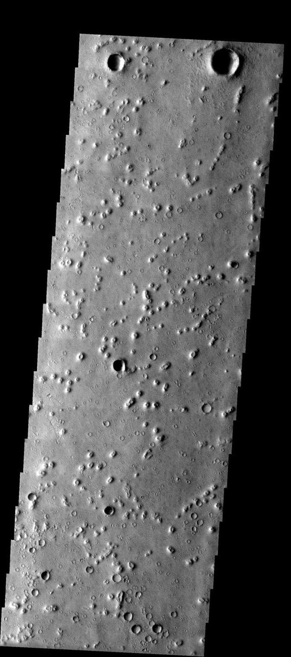 NASA's Mars Odyssey spacecraft captured this image in July 2003 of small hills/mounds in Isidis Planitia on Mars which may be of volcanic origin or alternatively eroded impact craters called pedestal craters.