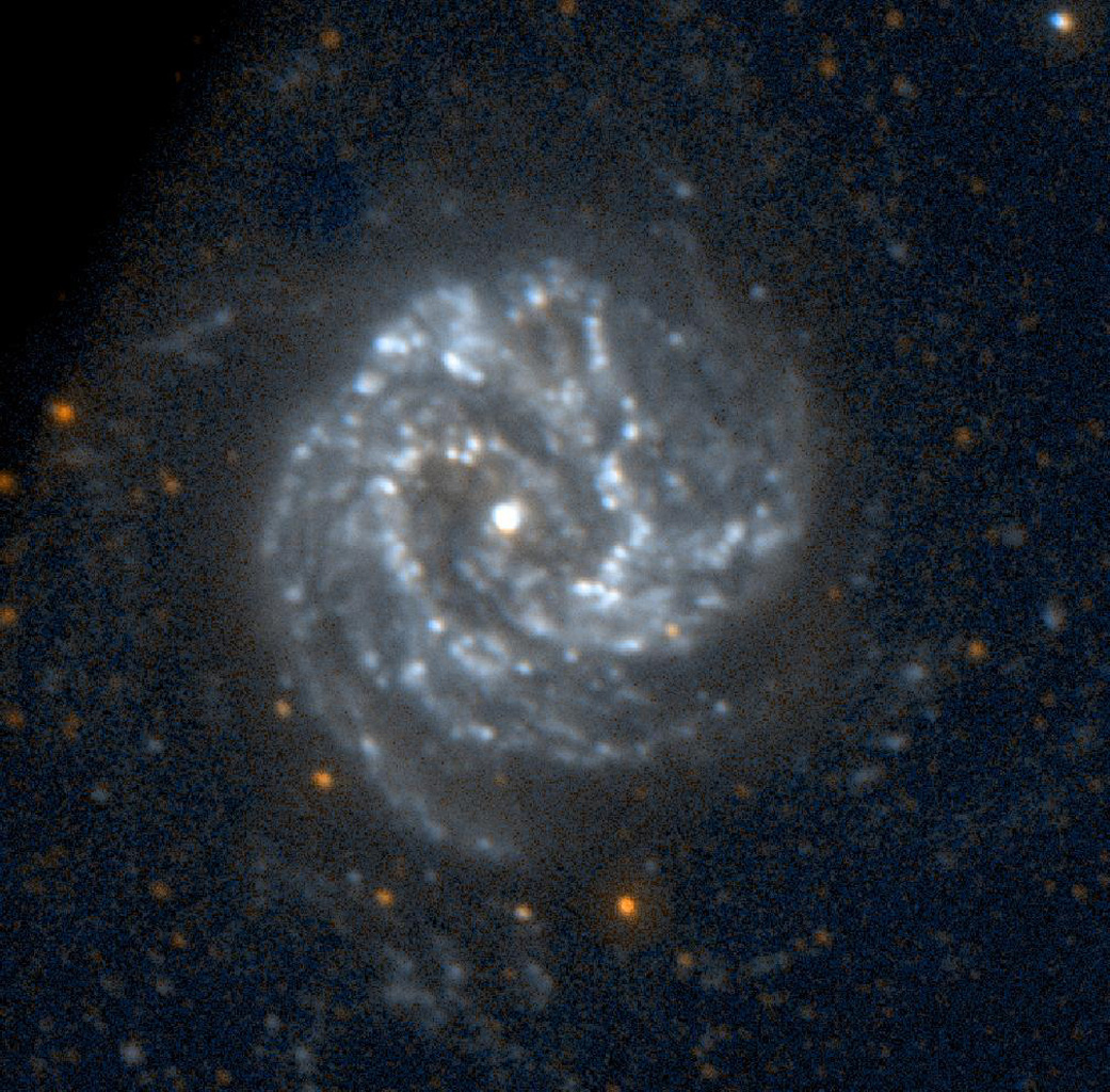 This image of the spiral galaxy Messier 83 was taken by NASA's Galaxy Evolution Explorer on June 7, 2003. Located 15 million light years from Earth and known as the Southern Pinwheel Galaxy,