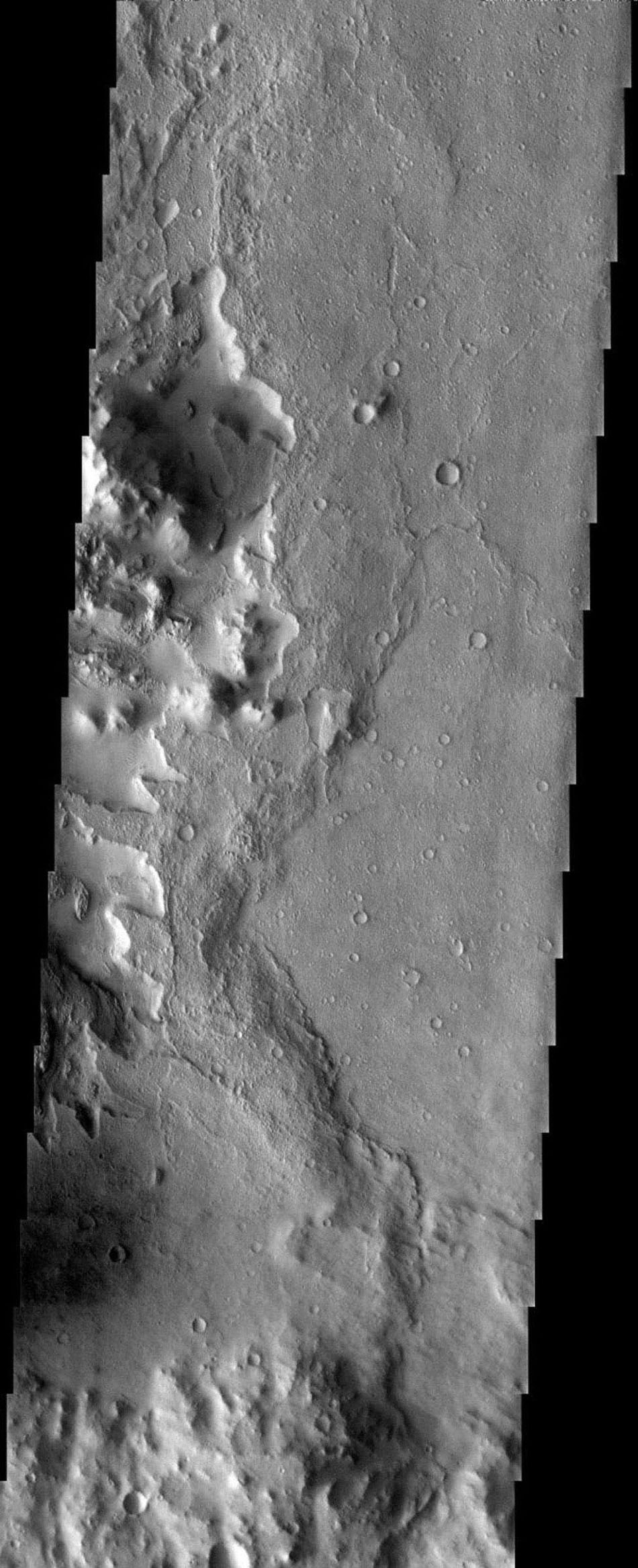 NASA's Mars Odyssey spacecraft captured this image in July 2003, showing the central uplift of an impact crater on Mars that formed by inward and upward movement of material below the crater floor during the crater-forming event.