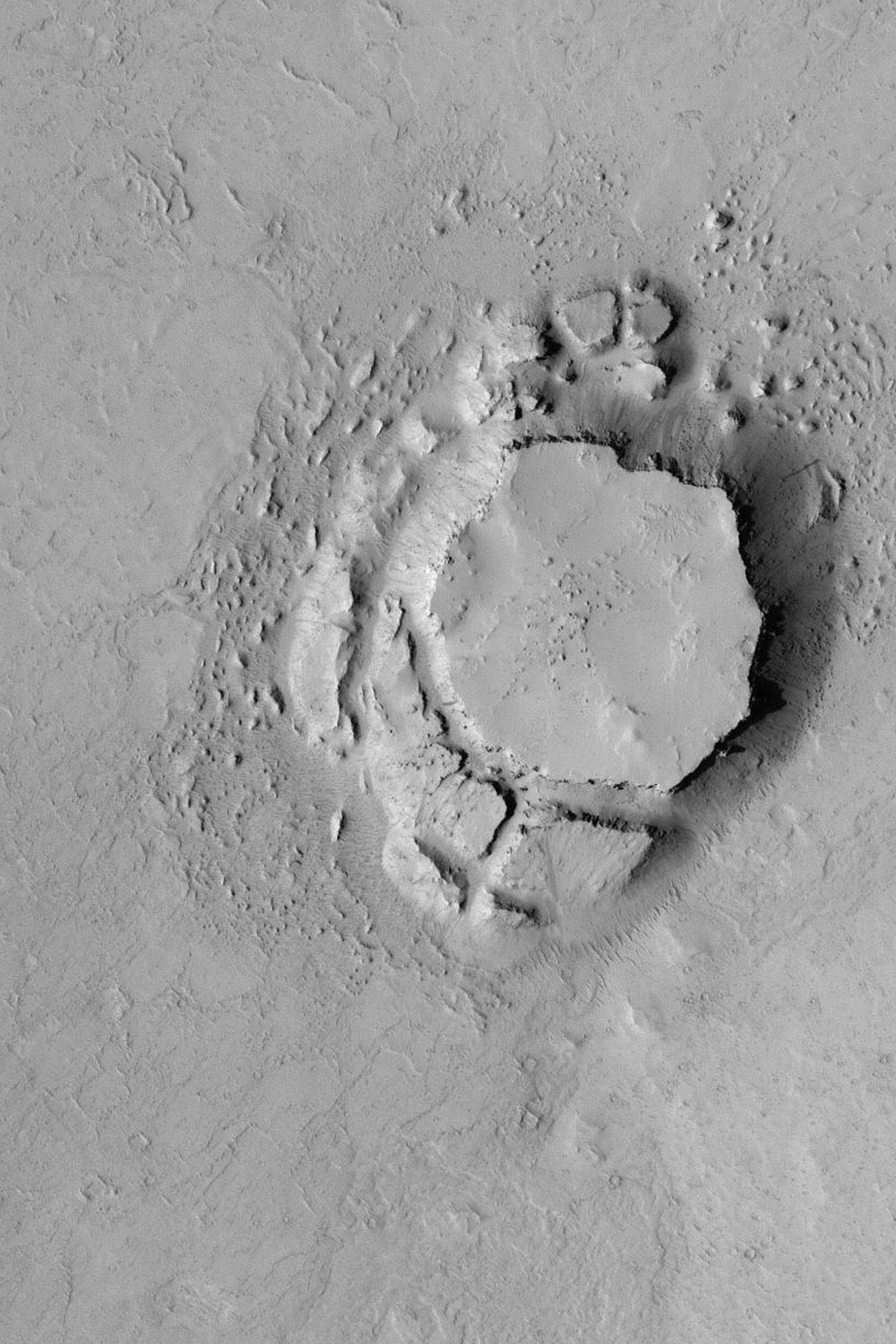 NASA's Mars Global Surveyor shows a mesa in the Avernus Colles region of Mars. The mesa and very large blocks that have been shed from its slopes are evident.