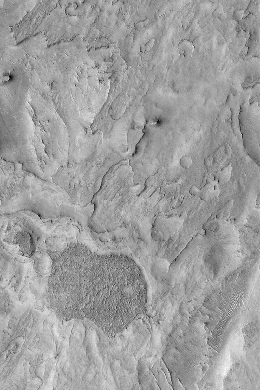 NASA's Mars Global Surveyor shows some of the eroded terrain in northeast Arabia Terra near Huo Hsing Vallis on Mars. The terrain is layered, and these layers have been eroded.