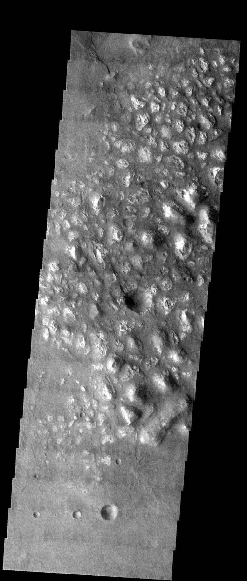 NASA's Mars Odyssey spacecraft captured this image in August 2003, showing knobby terrain is in the southern highlands on Mars.