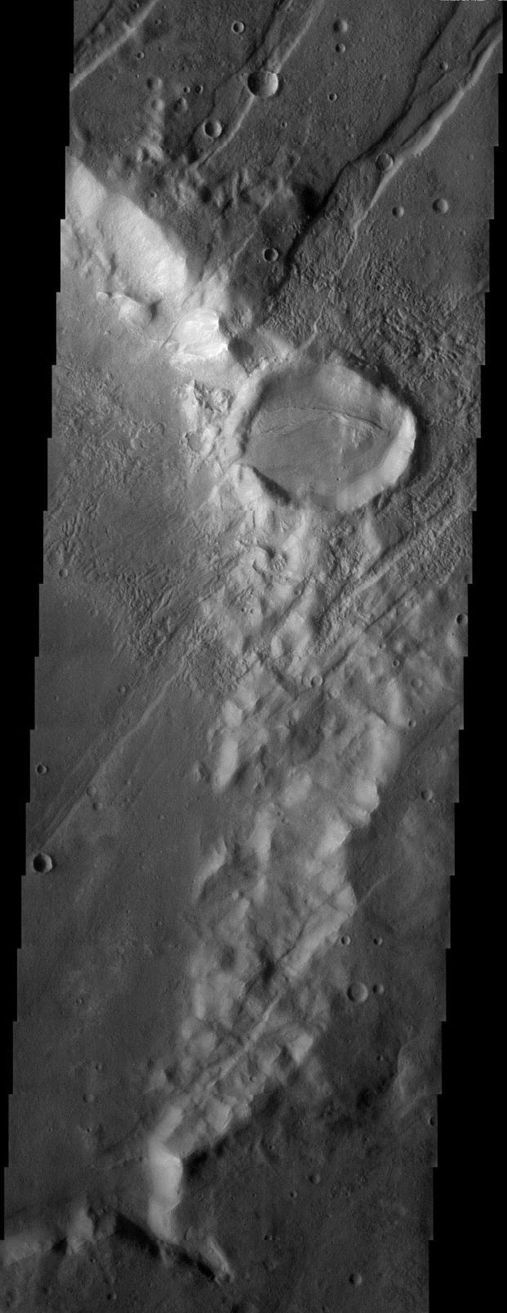 NASA's Mars Odyssey spacecraft captured this image in August 2003, showing large grooves indicating tectonic faulting cross just south of the Tharsis Monteson Mars.
