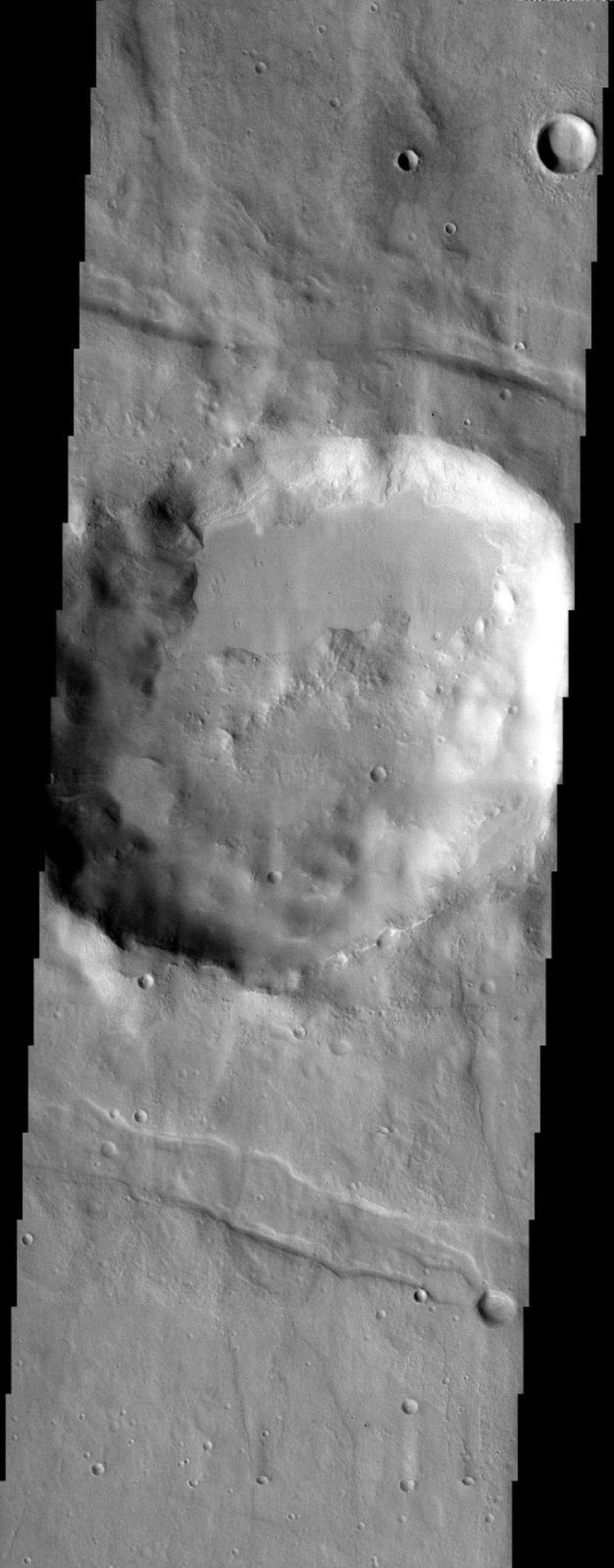 NASA's Mars Odyssey spacecraft captured this image in August 2003, showing a crater on Mars in the rugged Thaumasia uplands surrounding Solis Lacus containing an unusual filling of smooth material ramped up against the crater rim.