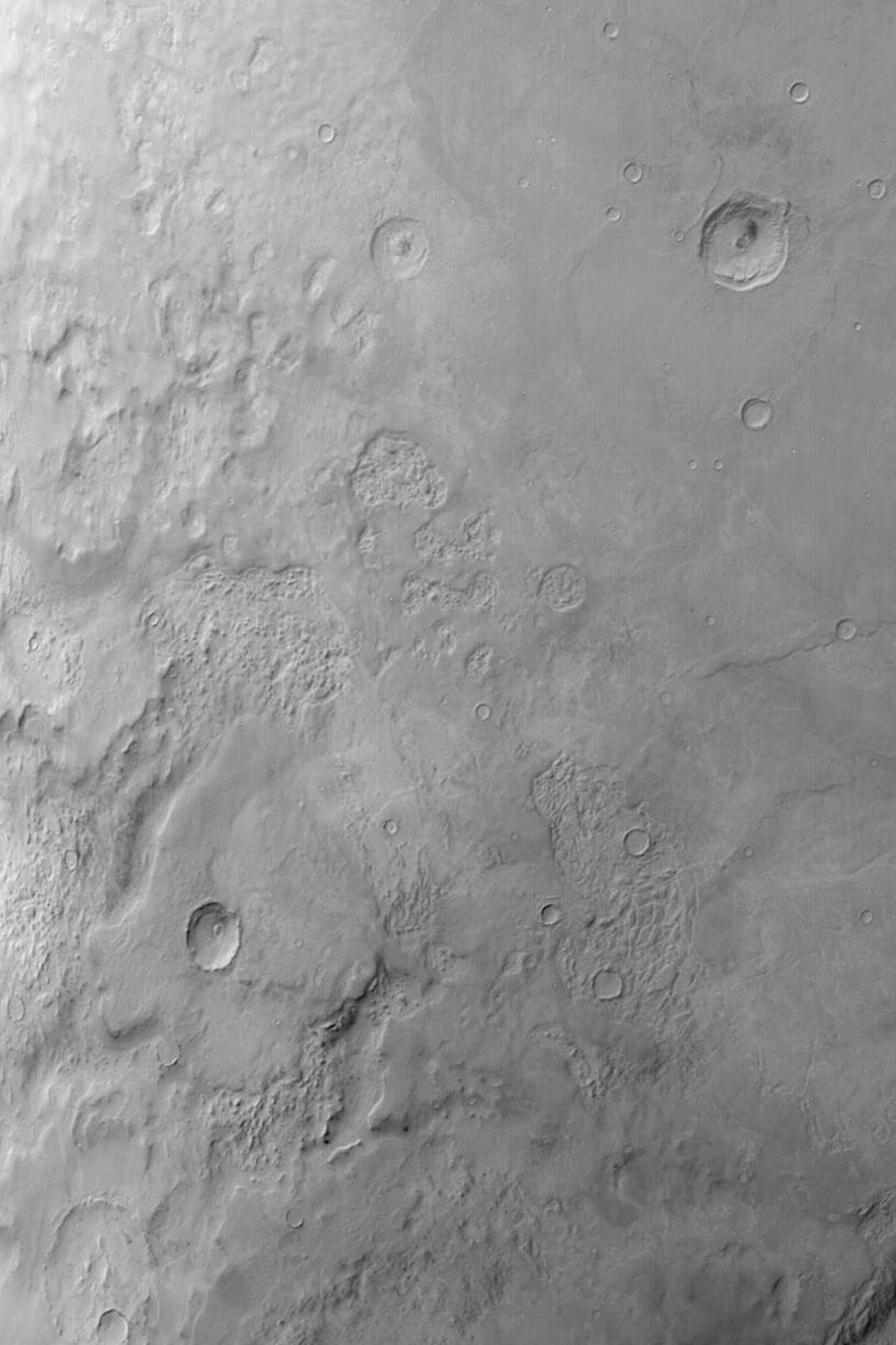 NASA's Mars Global Surveyor shows Hellas Planitia on Mars, the floor of a giant basin that originally formed by the impact of a large comet or asteroid.
