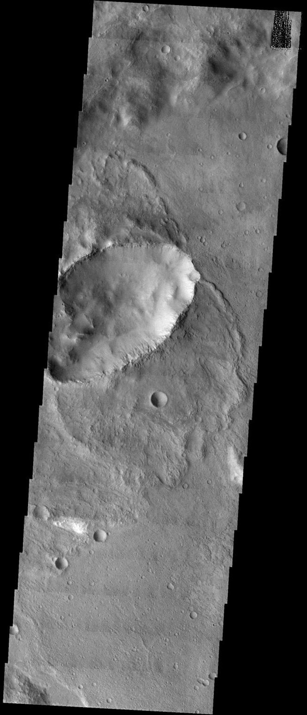 NASA's Mars Odyssey spacecraft captured this image in September 2003, showing heavily cratered southern highlands of Mars. Elliptical craters with 'butterfly' ejecta patterns make up roughly 5% of the total crater population of Mars.