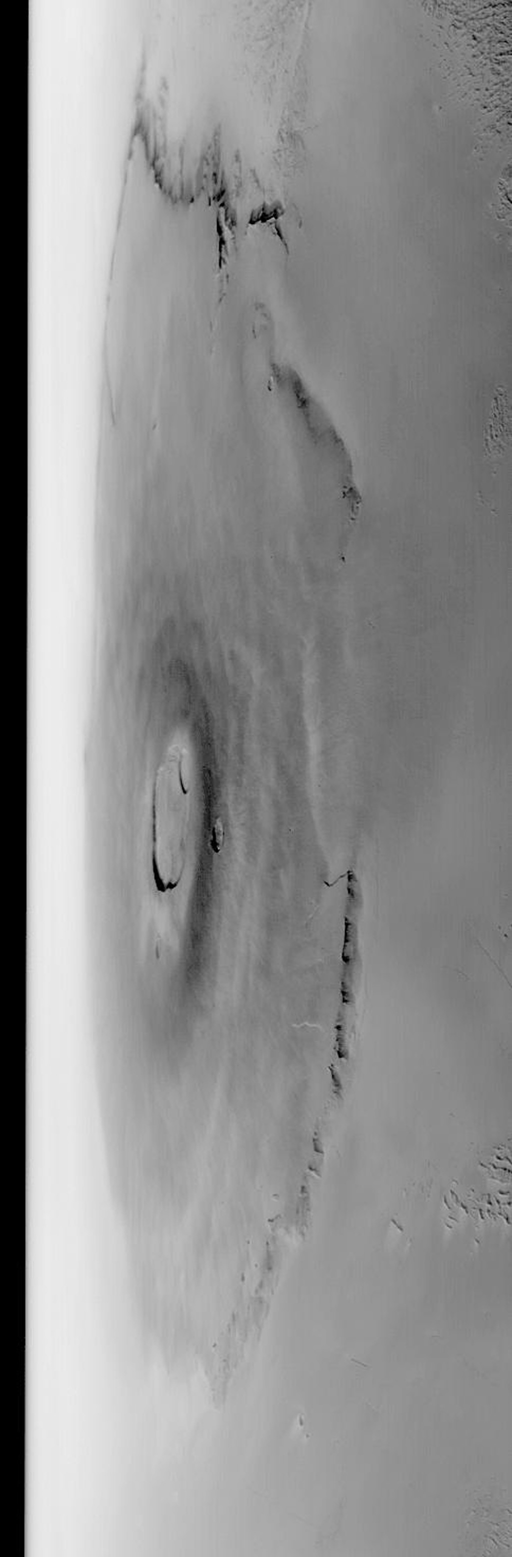 NASA's Mars Global Surveyor shows a wide angle view of the giant martian volcano, Olympus Mons.