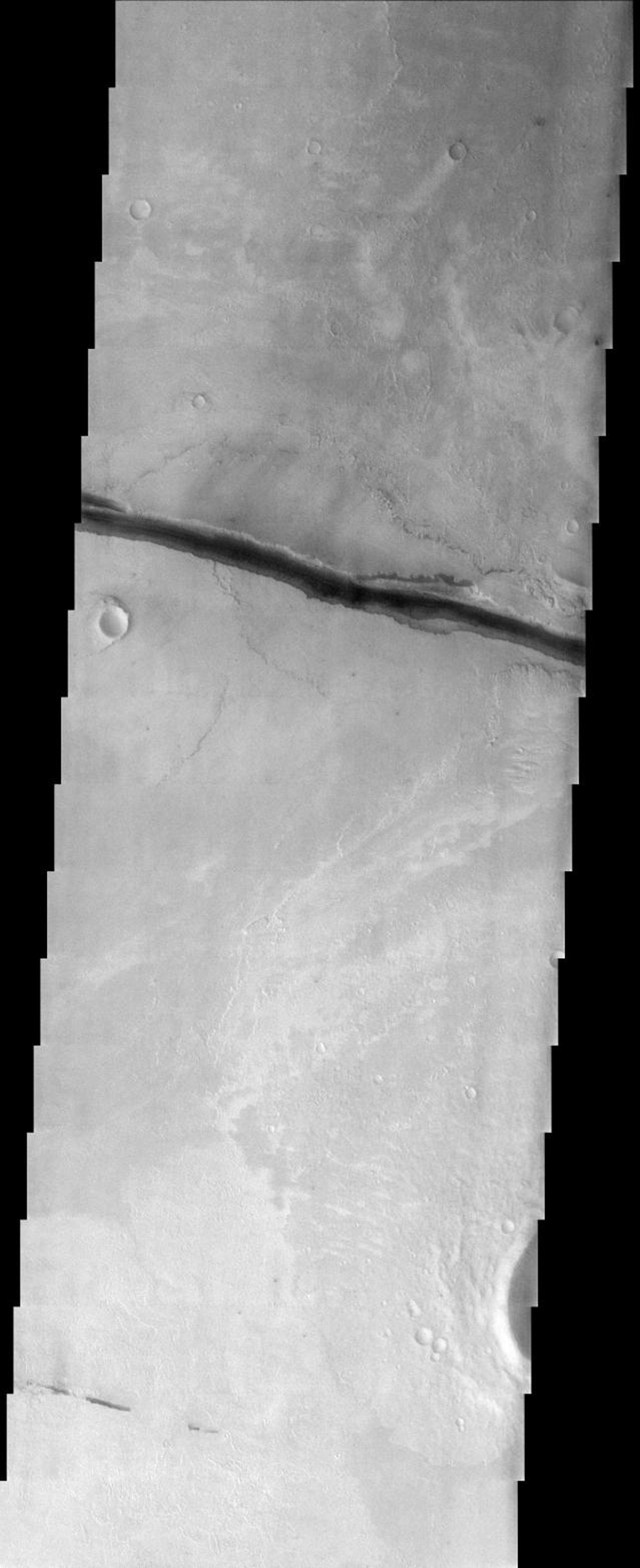 NASA's Mars Odyssey spacecraft captured this image in Sept 2003, shows that crustal fractures may have been the source for outpourings of water and lava. Conversely, the fractures may have formed after the fluvial and volcanic activity in this region.