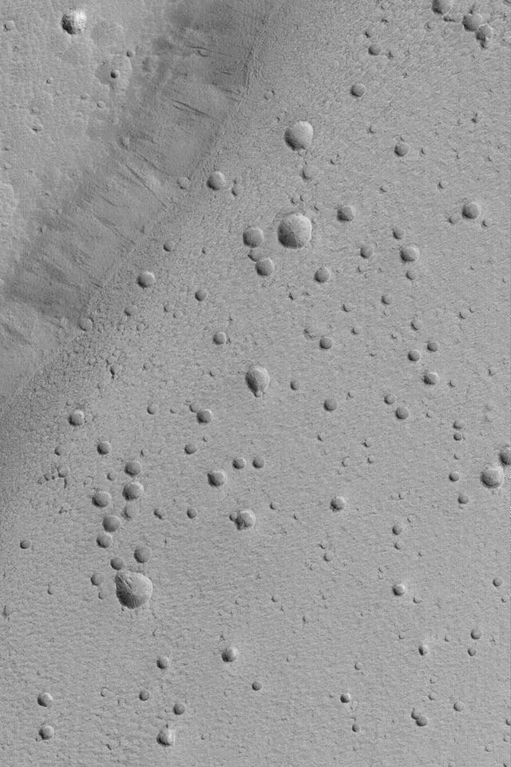 NASA's Mars Global Surveyor shows the pitted floor of the caldera of the martian volcano, Ceraunius Tholus. A caldera is a large collapse pit at the summit of a volcano.
