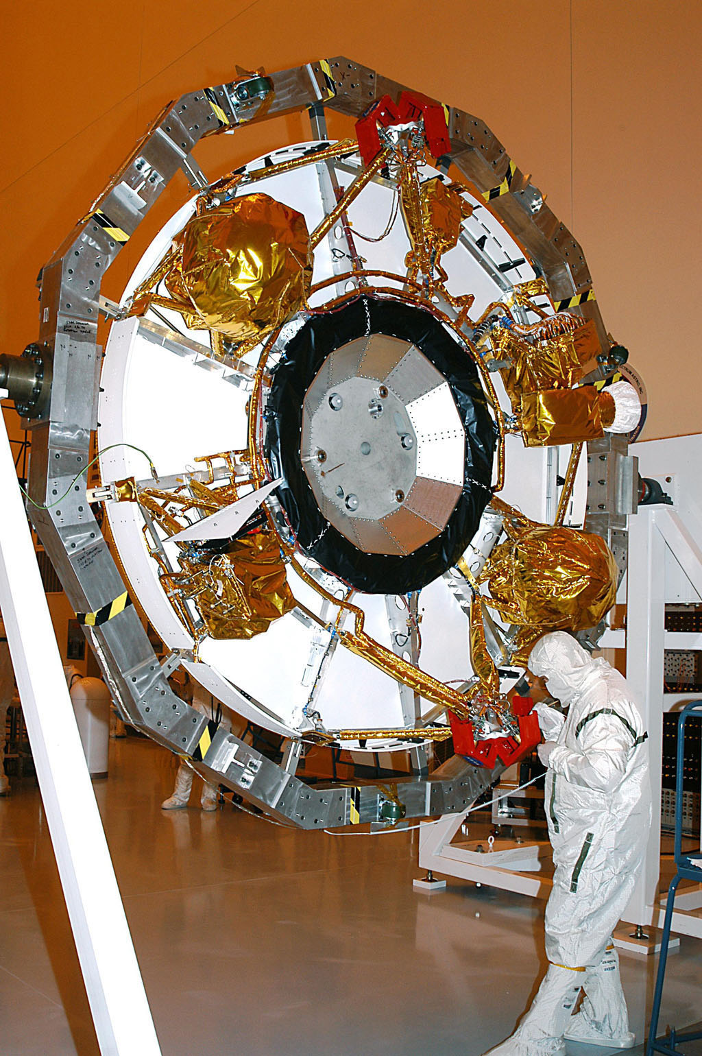 The aeroshell for Mars Exploration Rover 2 rests on end after rotation in the Payload Hazardous Servicing Facility.