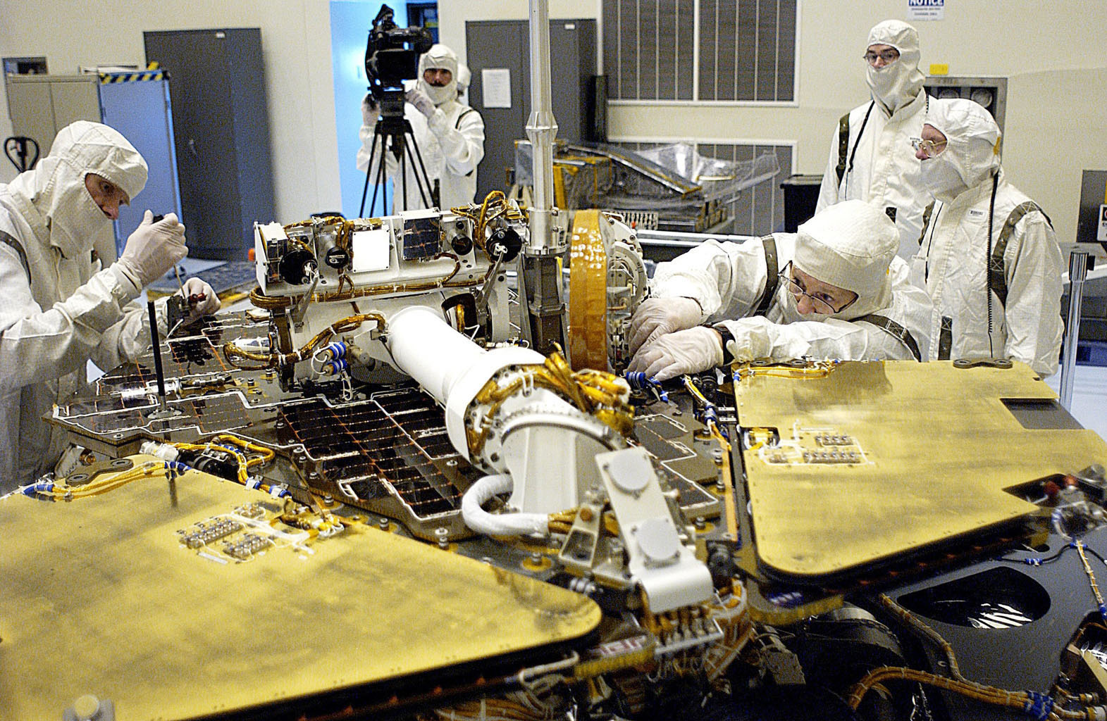 In the Payload Hazardous Servicing Facility, technicians remove one of the circuit boards on the Mars Exploration Rover 2 (MER-2).