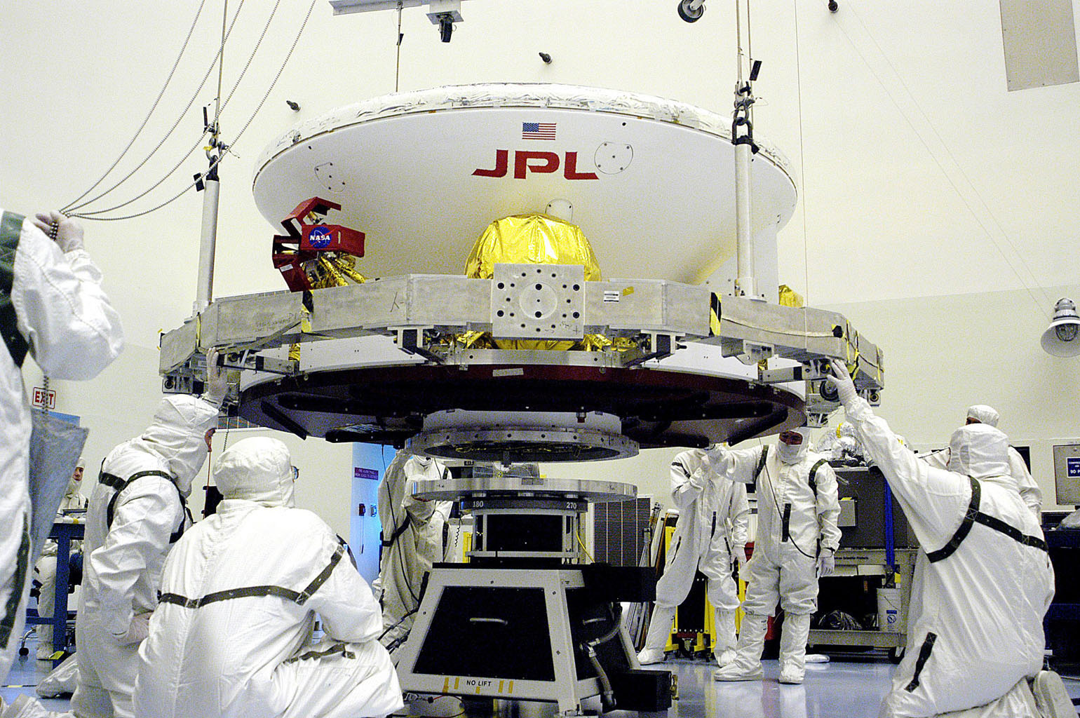 In the Payload Hazardous Servicing Facility, workers prepare to lift the Mars Exploration Rover-1 (MER-B) onto a spin table during preflight processing of the spacecraft.