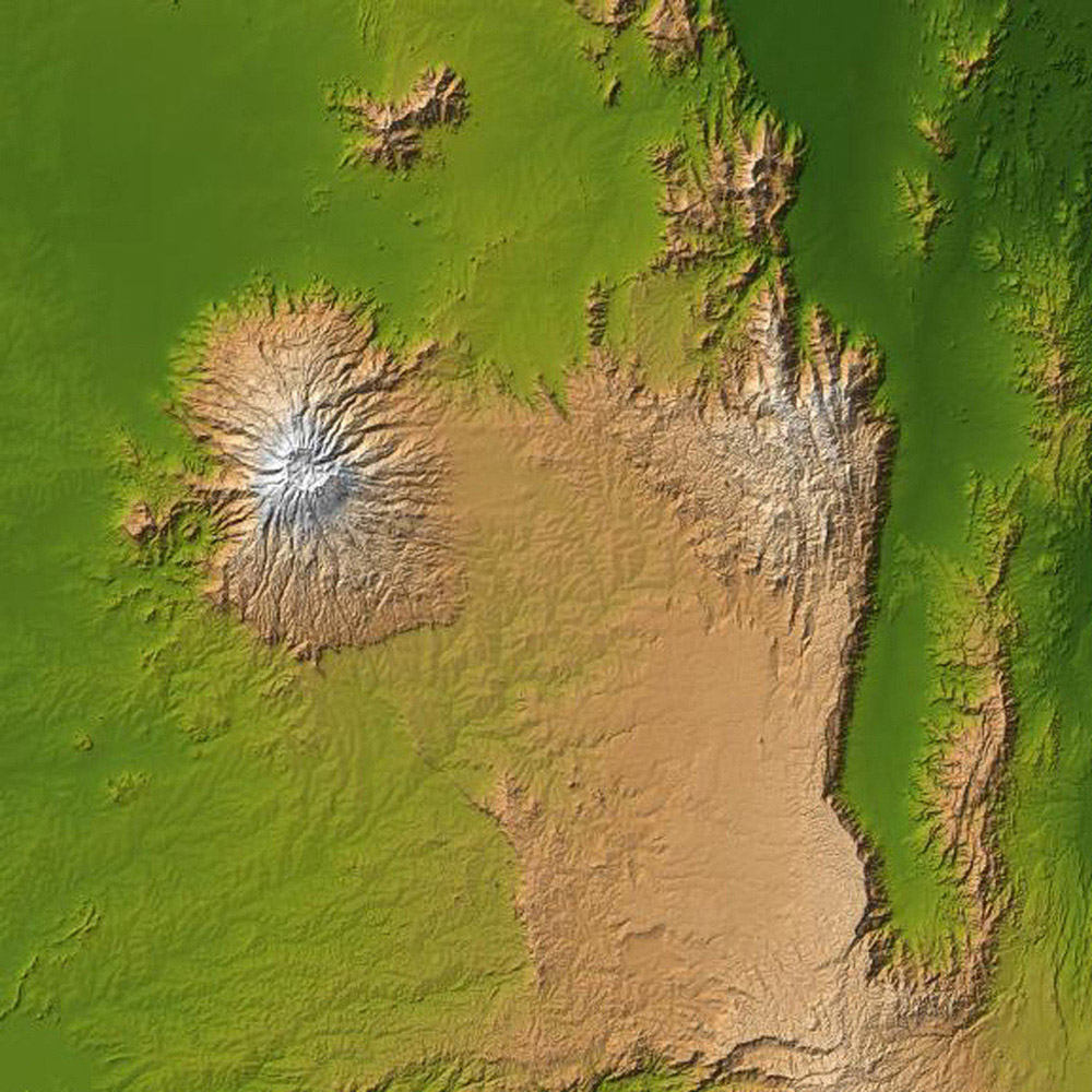 The striking contrast of geologic structures in Africa is shown in this shaded relief image of Mt. Elgon on the left and a section of the Great Rift Valley on the right as seen by NASA's Shuttle Radar Topography Mission.