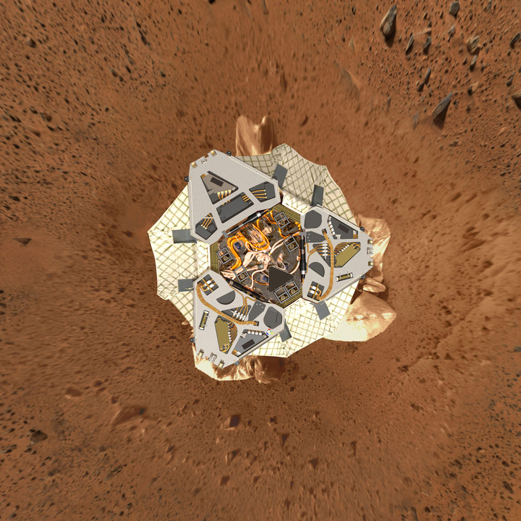 This high-resolution image shows a computer-generated model of Spirit's lander at Gusev Crater as engineers and scientists would have expected to see it from a perfect overhead view.