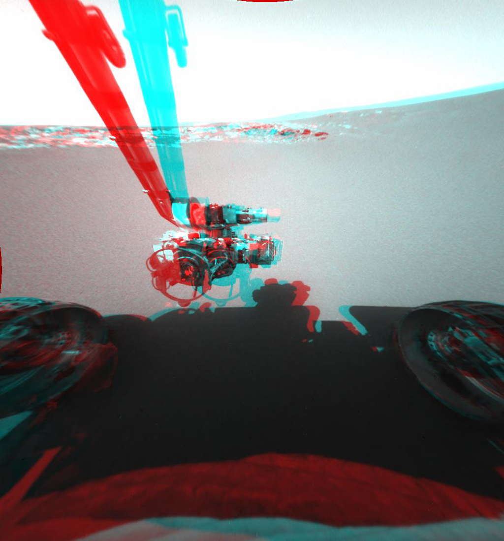 This is a three-dimensional stereo anaglyph of an image taken by the front hazard-identification camera onboard NASA's Mars Exploration Rover Opportunity, showing the rover's arm in its extended position. 3D glasses are necessary to view this image.