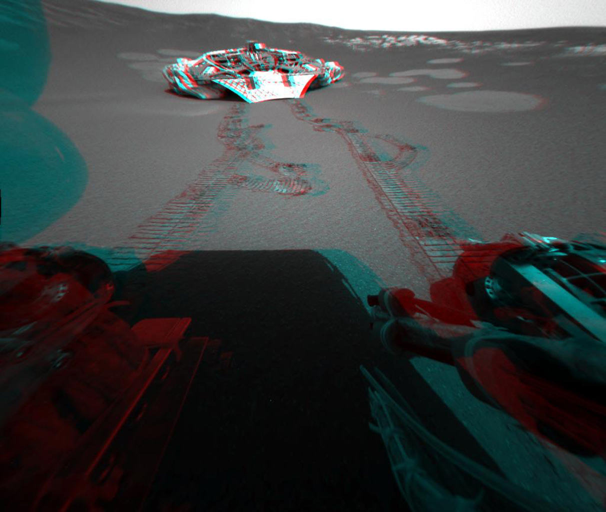 This 3-D view from behind NASA's Mars Exploration Rover Opportunity shows the path the rover has traveled since rolling 1 meter (3 feet) away from its empty lander on the seventh martian day, or sol, of its mission. 3D glasses are necessary.