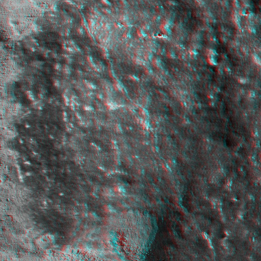 This 3D anaglyph, from NASA's Mars Exploration Rover Spirit, shows a microscopic image taken of the rock called Adirondack. 3D glasses are necessary to view this image.