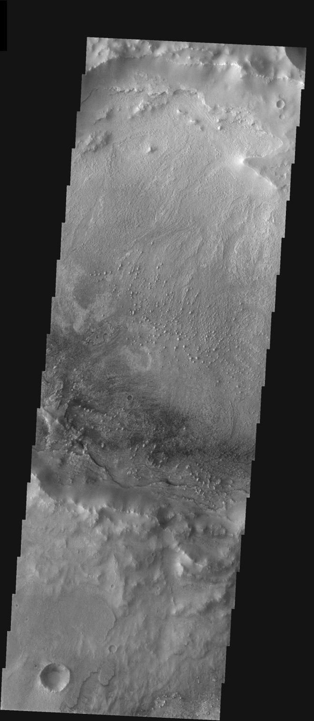 This image from NASA's 2001 Mars Odyssey released on Jan 28, 2004 shows layered material in a crater on Meridiani Planum on Mars.