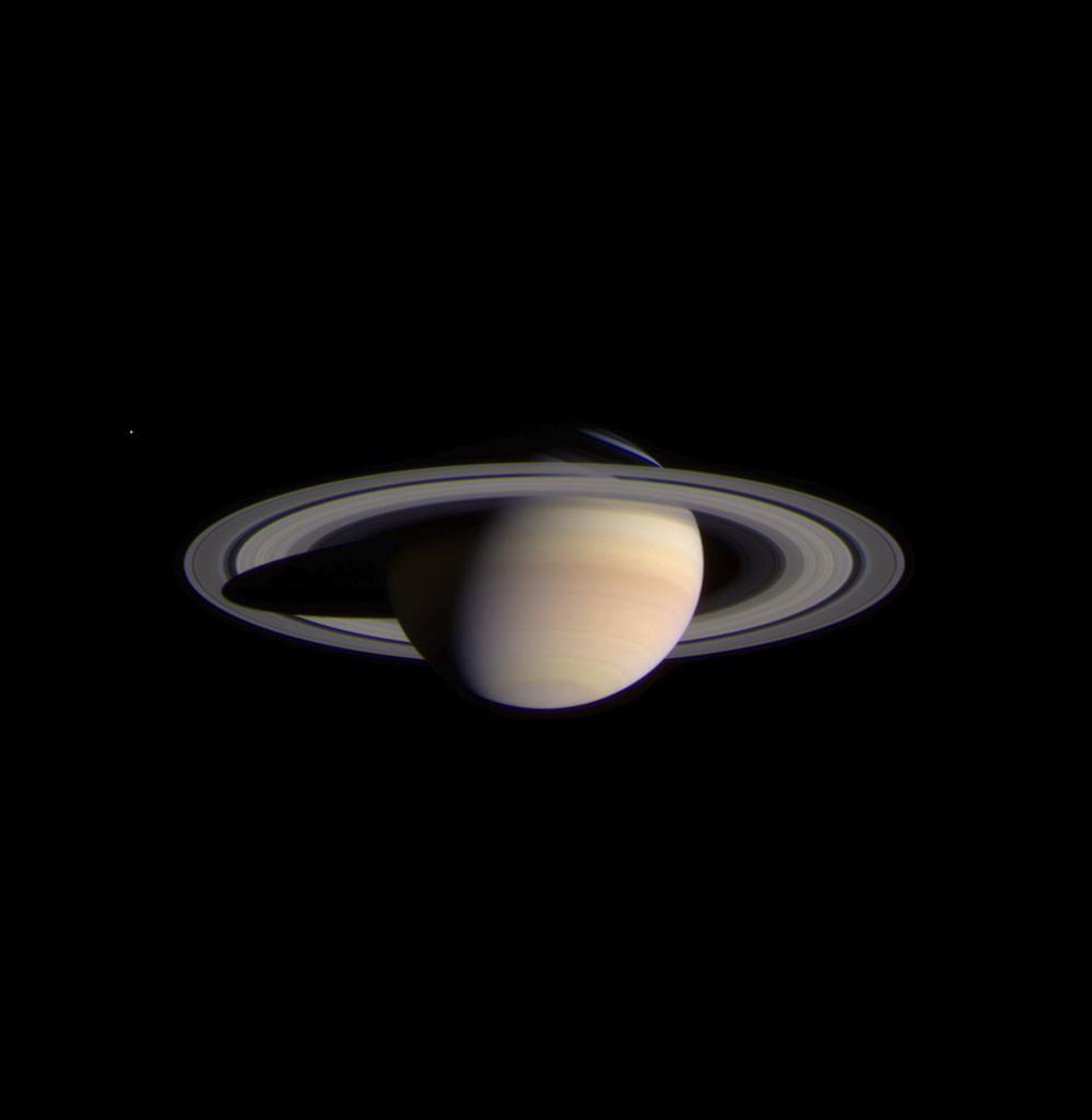 The narrow angle camera onboard NASA's Cassini spacecraft took a series of exposures of Saturn and its rings and moons on February 9, 2004, which were composited to create this stunning, color image.