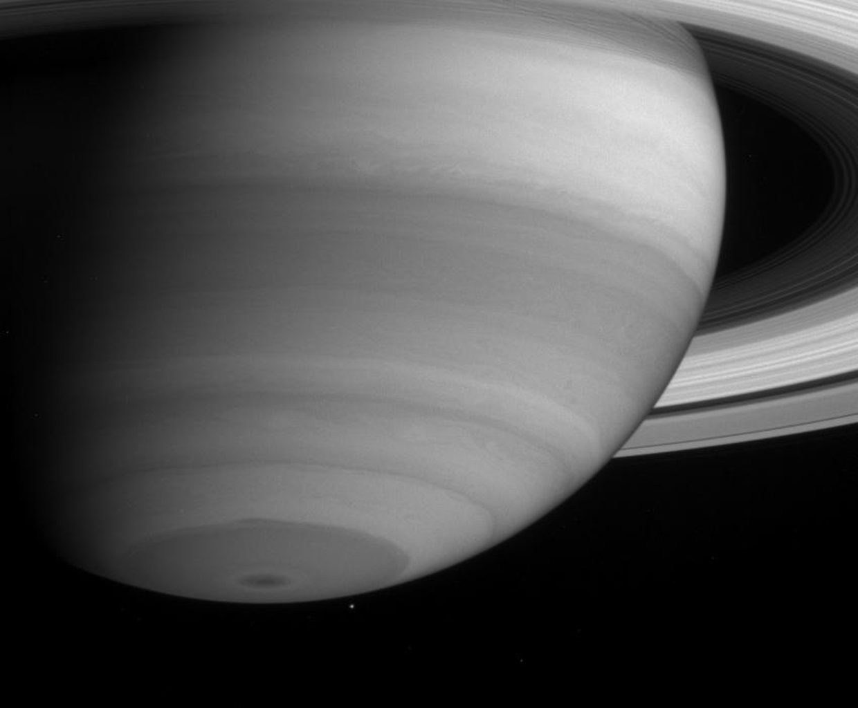 Saturn's captivating cloud bands display a number of interesting features in this narrow angle camera image taken by NASA's Cassini spacecraft on May 20, 2004.