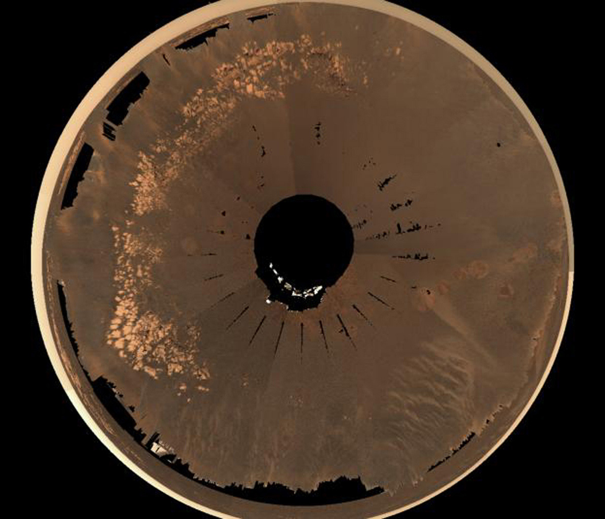 This image shows an overhead view of NASA's Mars Exploration Rover Opportunity landing site at Meridiani Planum, nicknamed 'EagleCrater.' Light and dark soil targets and an airbag bounce are seen at this spot dubbed 'Neopolitan.'