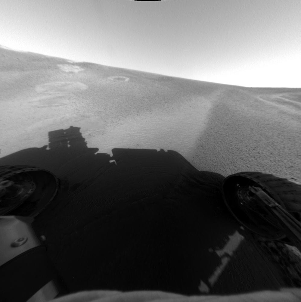 This image from NASA's Mars Exploration Rover Opportunity's front hazard-avoidance camera shows the rover at its Sol 53 (March 17, 2004) location within the 'Eagle Crater' landing site.