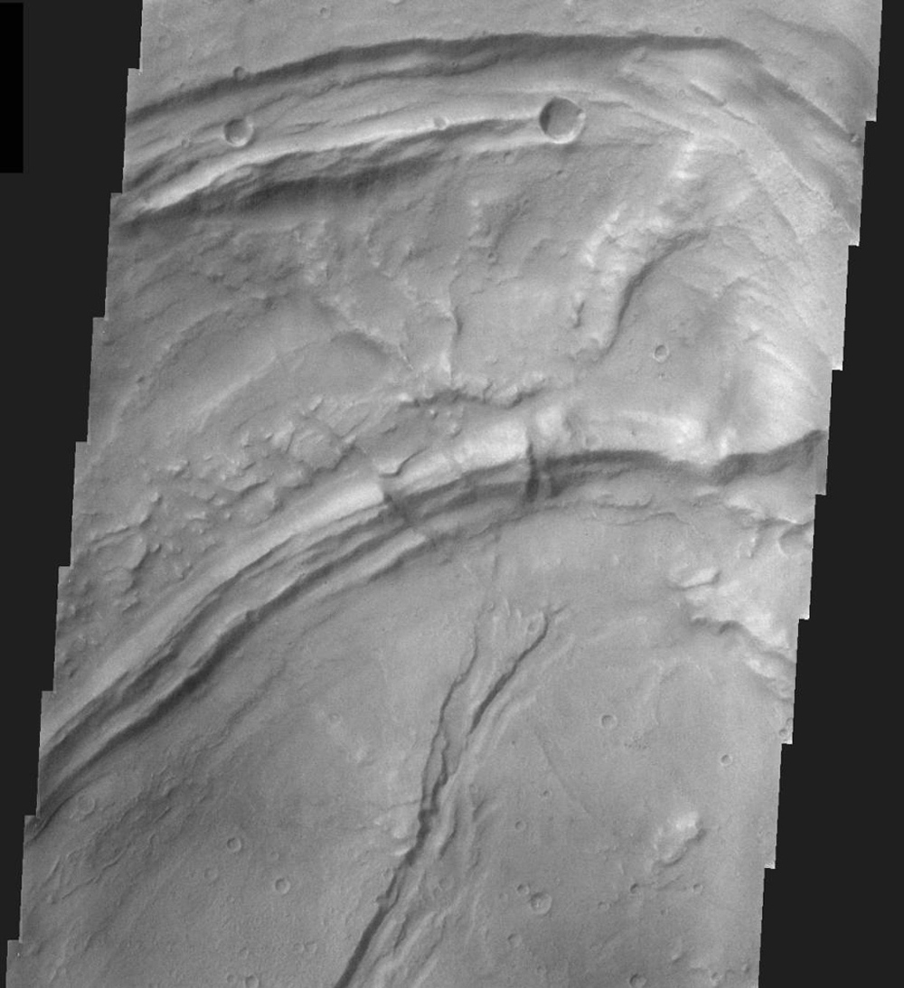 This image, part of an images as art series from NASA's 2001 Mars Odyssey released on March 3, 2004 shows a martian landscape resembling a toucan's beak.