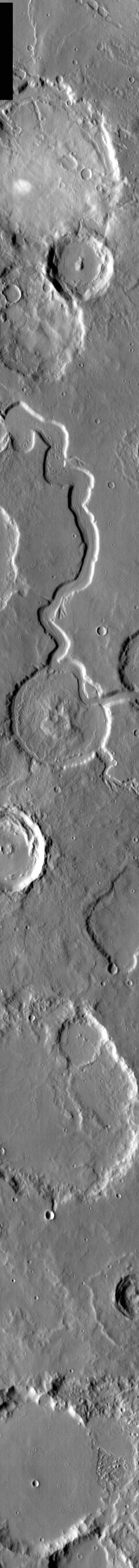 This image from NASA's 2001 Mars Odyssey released on March 18, 2004 shows a younger channel cutting through an older crater on Mars.