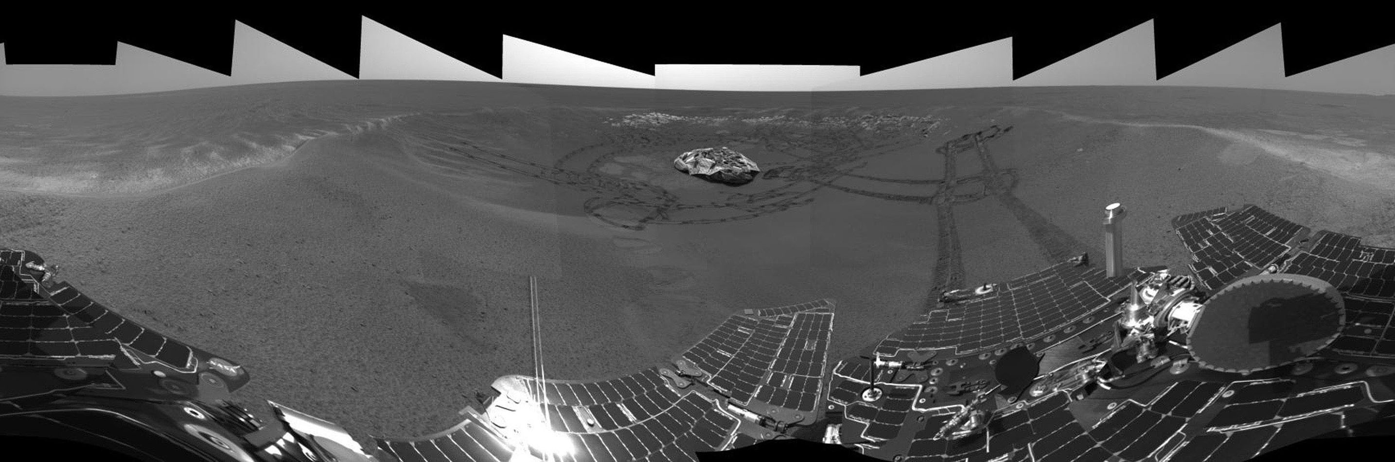 This image from NASA's Mars Exploration Rover Opportunity's view shows the rover's tracks visible at the original spot where the rover attempted unsuccessfully to exit its landing site crater in 2004.