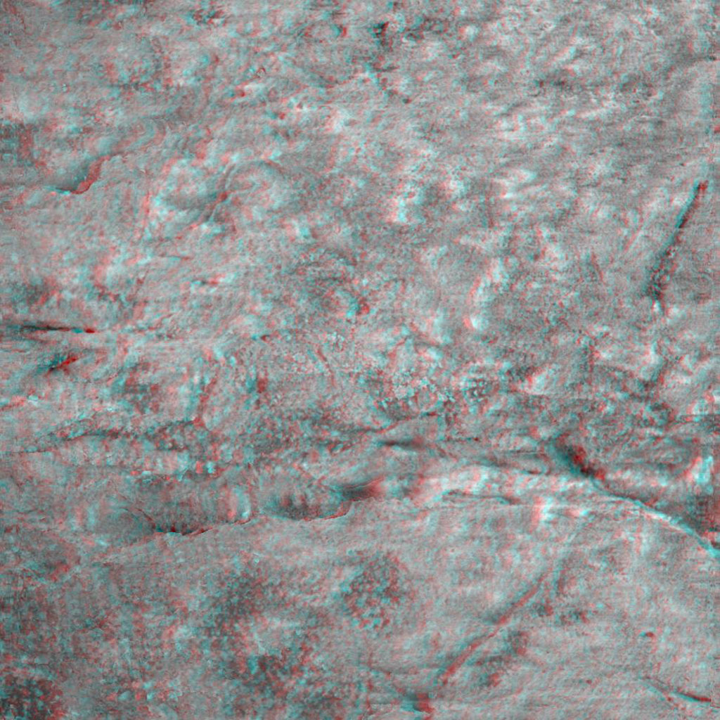 This 3-D image taken by the microscopic imager on NASA's Mars Exploration Rover Opportunity shows a close-up of the center of the rock abrasion tool hole, ground into 'Bounce.' 3D glasses are necessary to view this image.
