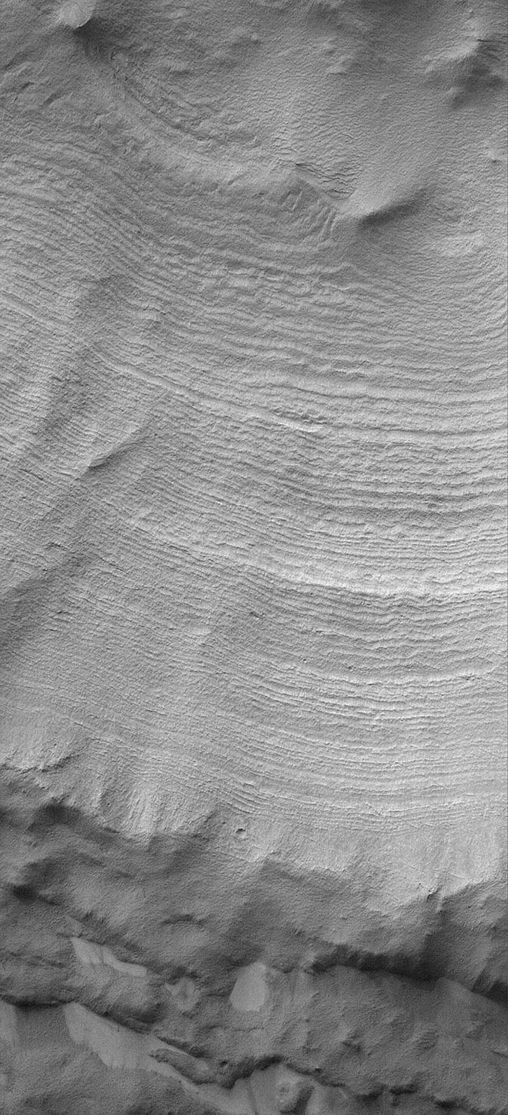 NASA's Mars Global Surveyor shows layers exposed in the walls of a crater-like form in the south polar region of Mars.