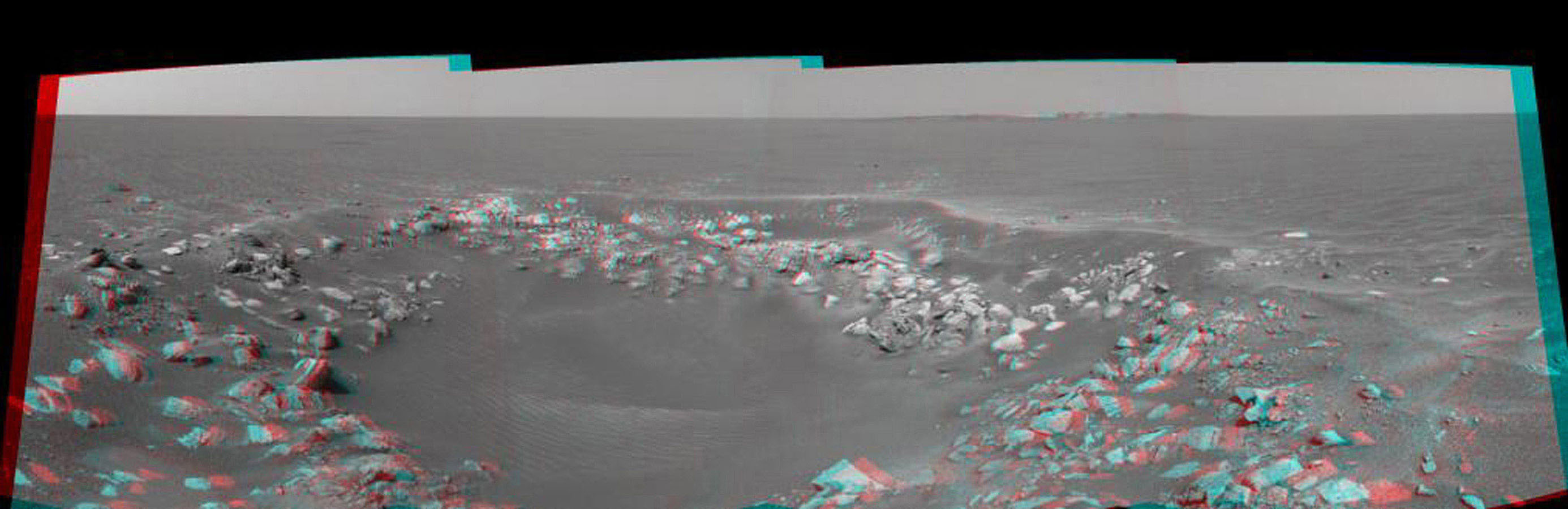 This 3-D cylindrical projection was taken by the navigation camera onboard NASA's Mars Exploration Rover Opportunity. This is a region dubbed 'Fram Crater' located .3 miles from 'Eagle Crater' and roughly 820 feet from 'Endurance Crater' (upper right).