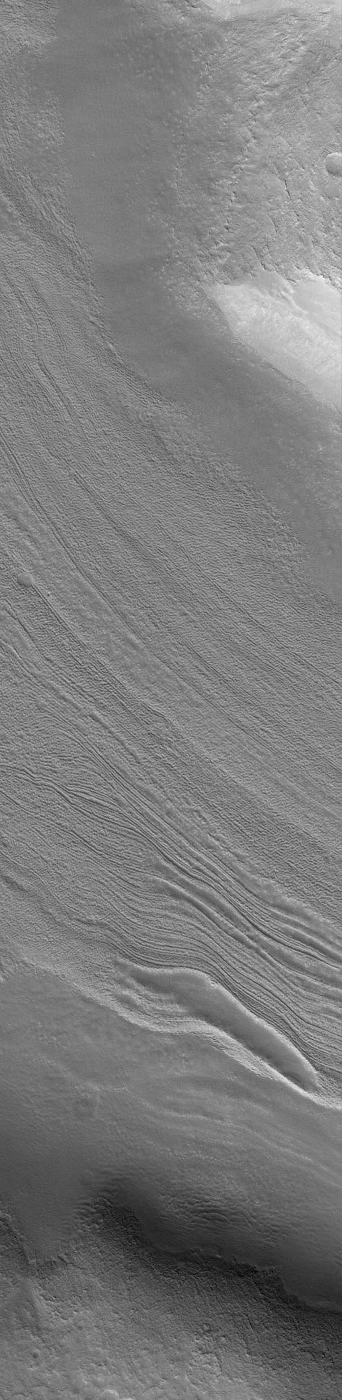 NASA's Mars Global Surveyor shows a typical fretted terrain valley floor, located southwest of Moreux Crater on Mars.