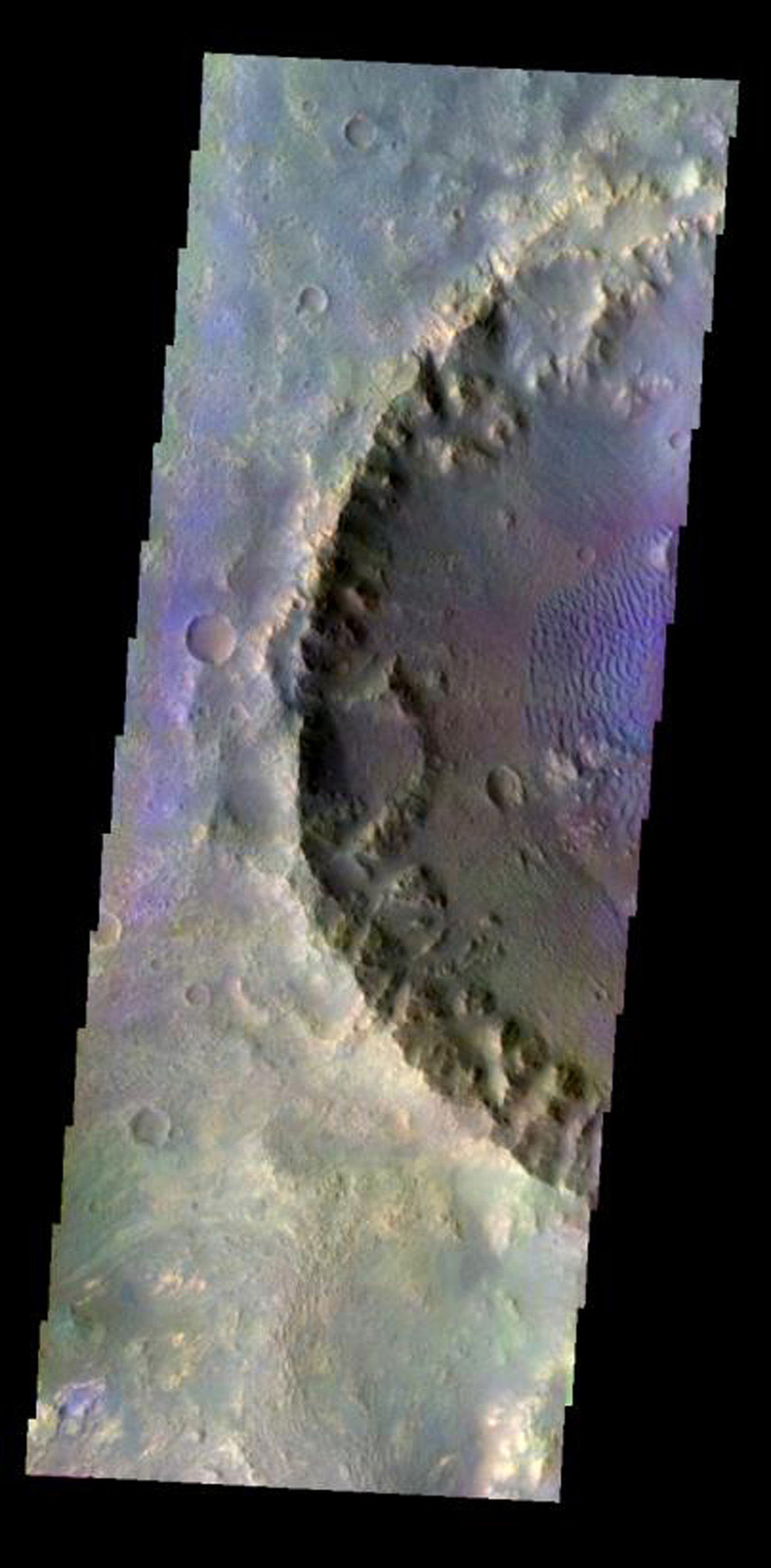 This color image from NASA's 2001 Mars Odyssey released on May 4, 2004 shows the martian surface during the southern summer season of a crater within Molesworth Crater.