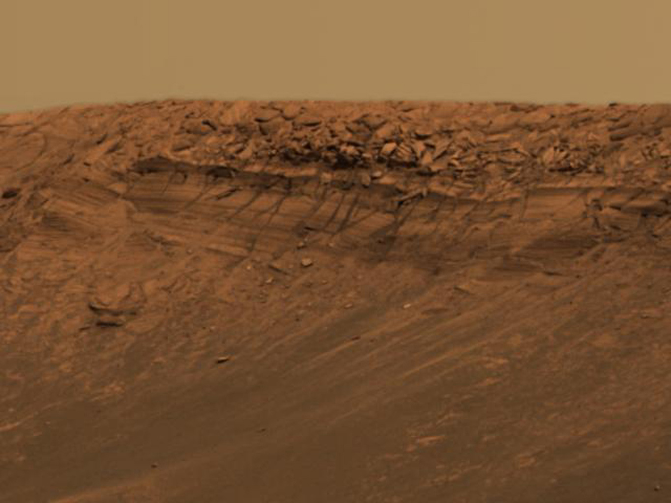 This approximate true-color image taken by the panoramic camera NASA's Mars Exploration Rover Opportunity highlights the vertical drop on a feature called 'Burns Cliff' within the impact crater known as 'Endurance.'