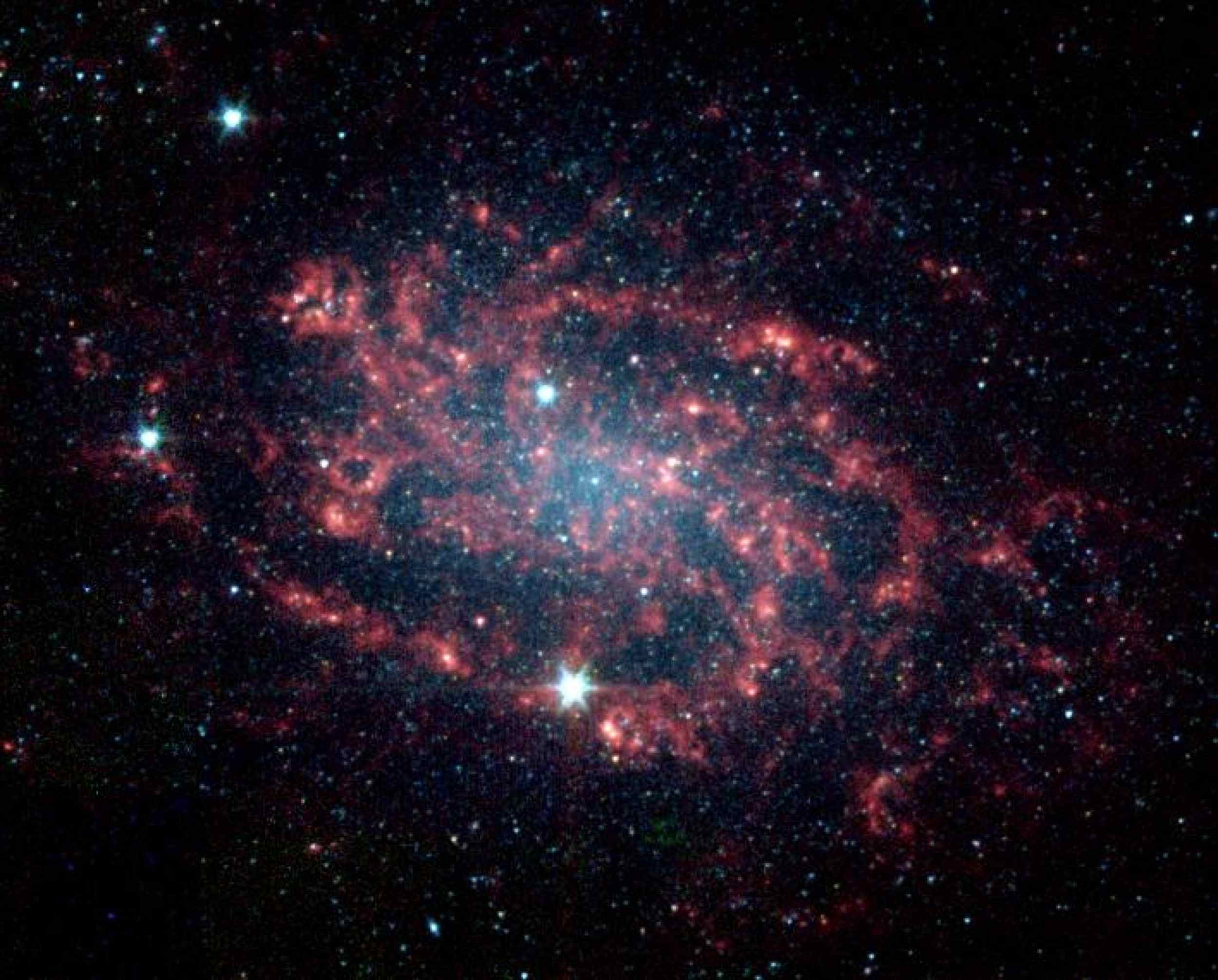 Sometimes, the best way to understand how something works is to take it apart. The same is true for galaxies like NGC 300, which NASA's Spitzer Space Telescope has divided into its various parts.