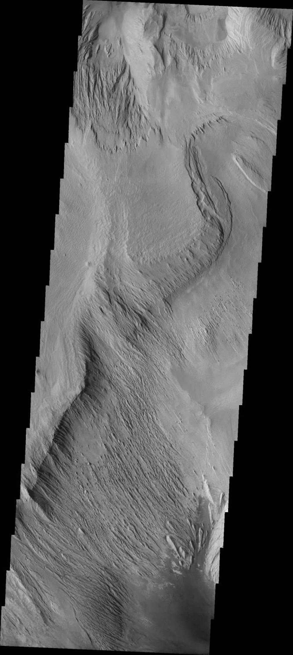 This image from NASA's 2001 Mars Odyssey released on Sept 15, 2004 shows the martian surface of Ophir Chasma, layered rock formations and wind etched rocks are present. The southern part of the image contains a dune field.