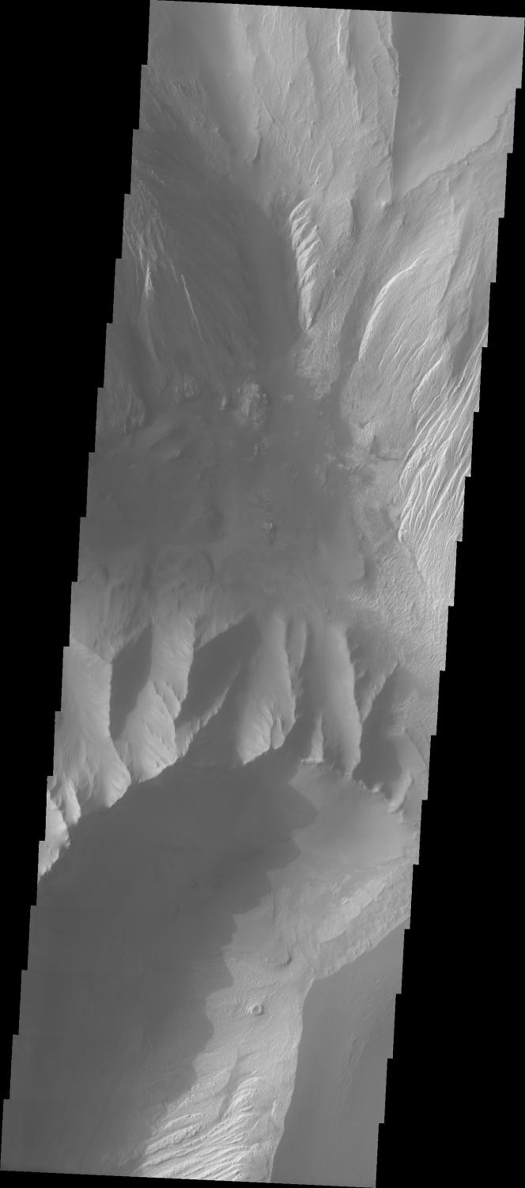 This image from NASA's 2001 Mars Odyssey released on Sept 20, 2004 shows the hills on Mars found between Ophir Chasma (northern part) and Candor Chasma. Multiple slides, dunes, and wind-eroded surfaces are present in this area.