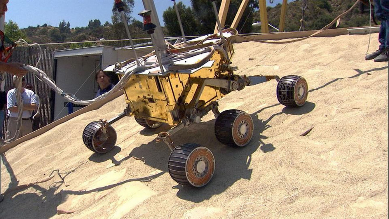 This image taken at NASA's Jet Propulsion Laboratory shows engineers rehearsing the sol 133 (June 8, 2004) drive into 'Endurance' crater by NASA's Mars Exploration Rover Opportunity.