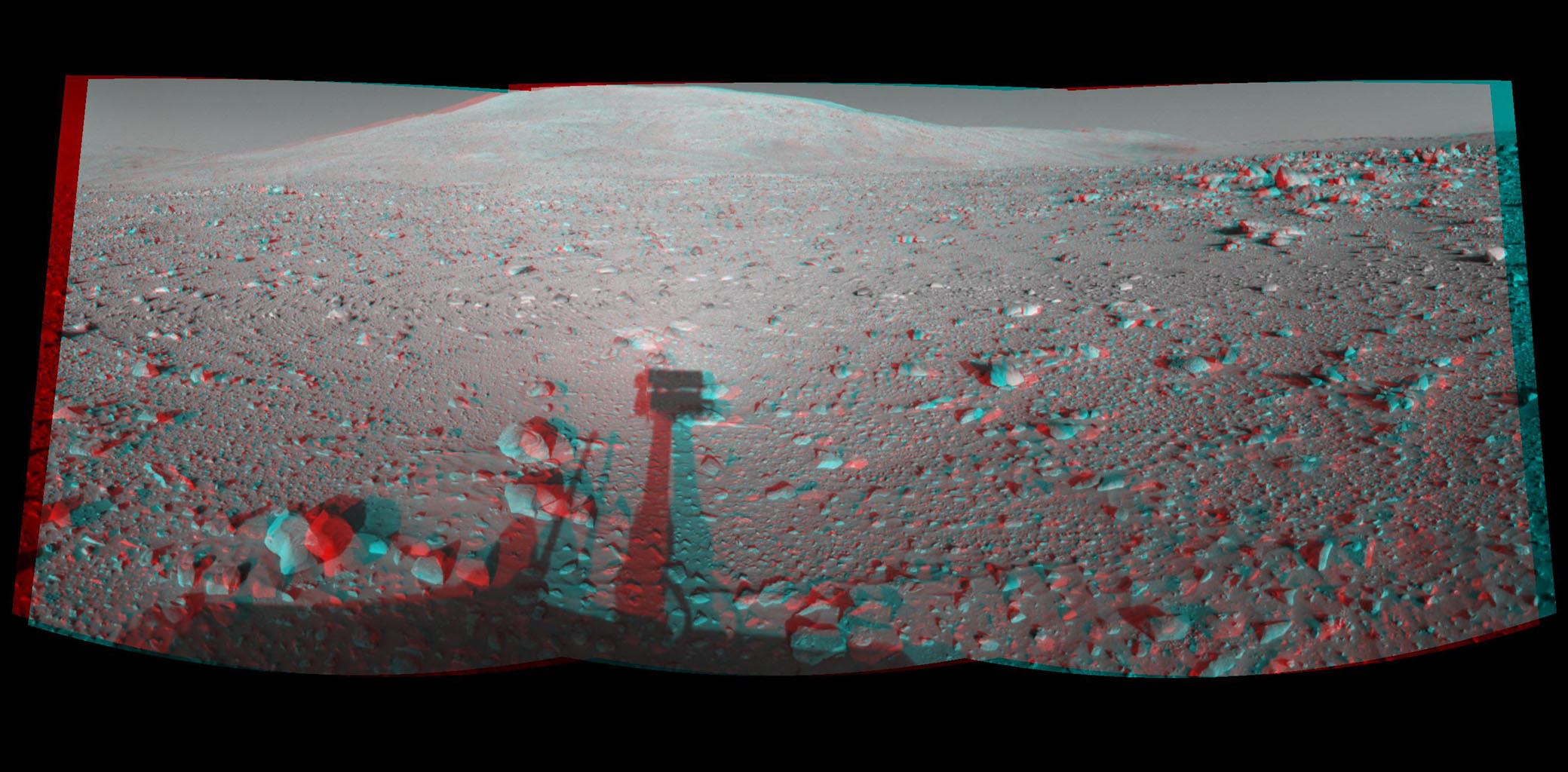 This 3-D cylindrical-perspective mosaic was created from navigation camera images that NASA's Mars Exploration Rover Spirit captured on on sol 153. 3D glasses are necessary to view this image.