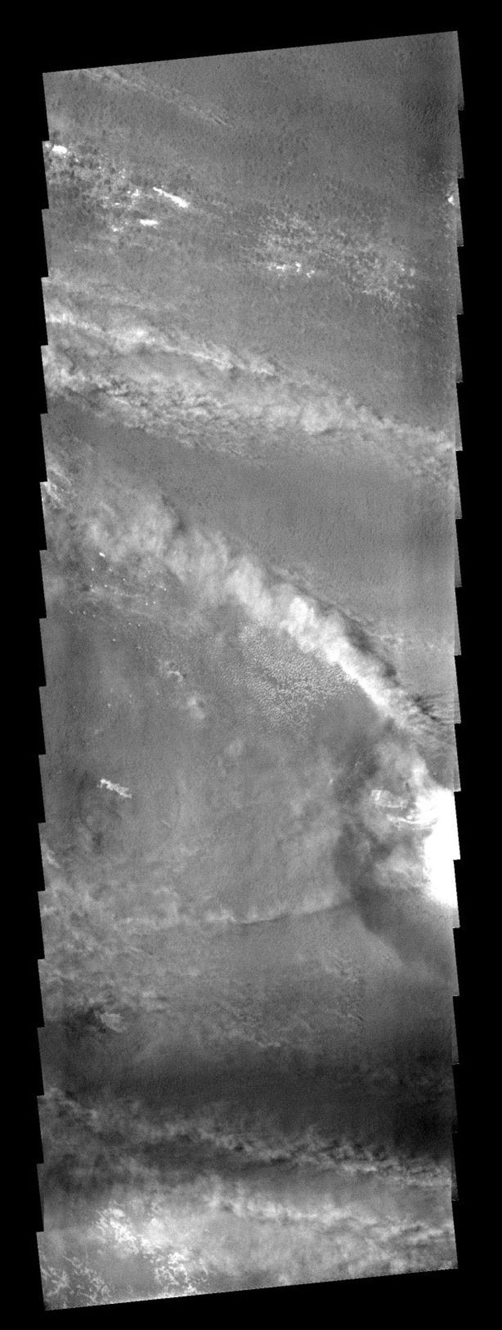 A bright line of clouds streaming off the north rim of the crater on Mars as seen by NASA's 2001 Mars Odyssey spacecraft.